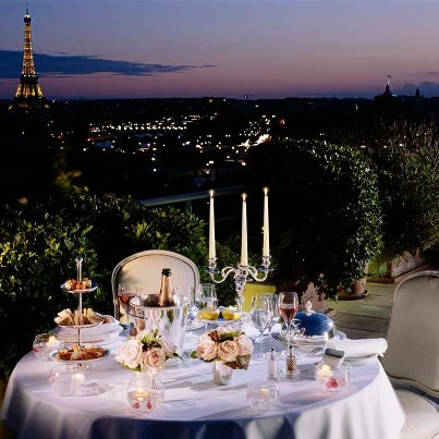 Who We Are image 2 table w Eiffel Tower view from Le Meurice